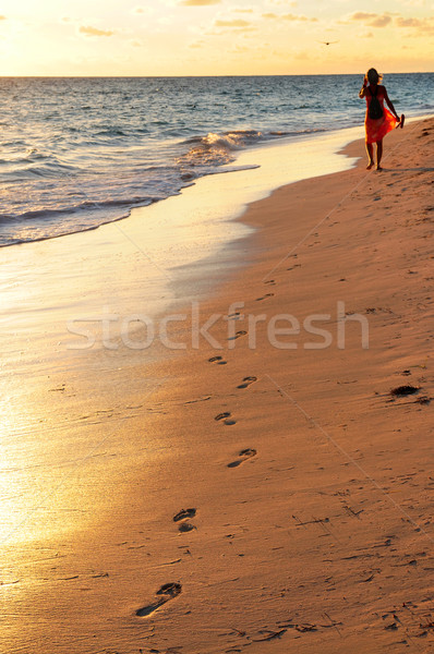 Woman walking on beach  Stock photo © elenaphoto