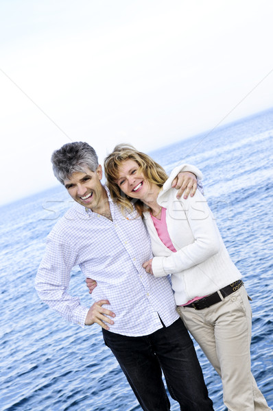 Mature romantic couple at seashore Stock photo © elenaphoto