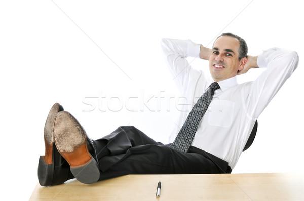 Relajante empresario pies hasta escritorio sonrisa Foto stock © elenaphoto