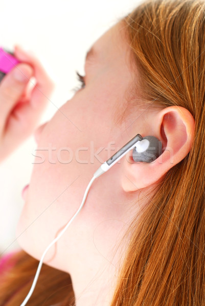 Girl listen music Stock photo © elenaphoto