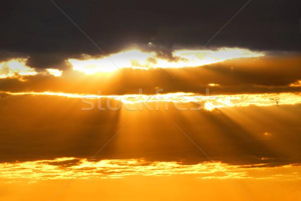 Sole raggi splendente nubi tramonto cielo Foto d'archivio © elenaphoto