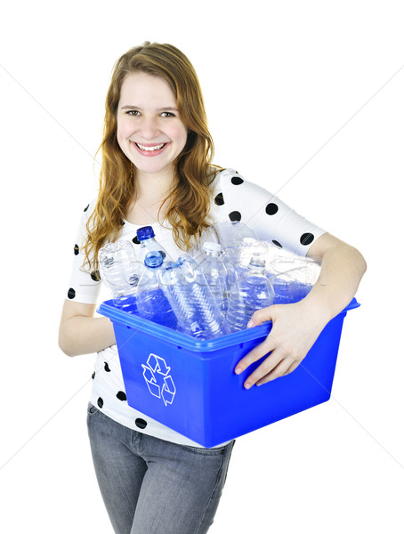 Young woman holding recycling box Stock photo © elenaphoto