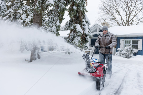 Man clearing driveway with snowblower Stock photo © elenaphoto