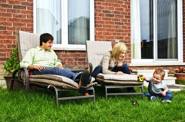 Happy family relaxing at home Stock photo © elenaphoto