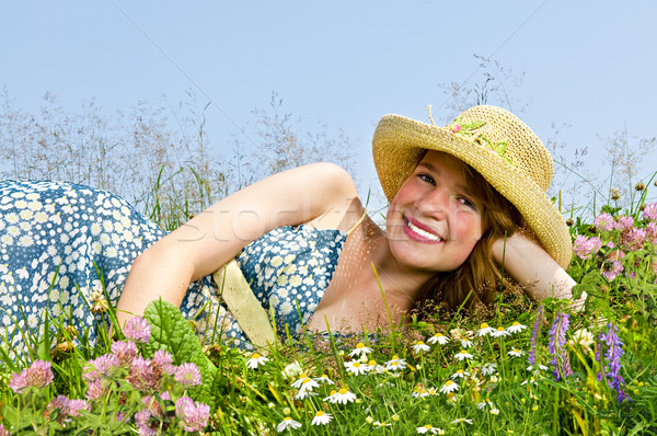 Young girl laying on meadow Stock photo © elenaphoto