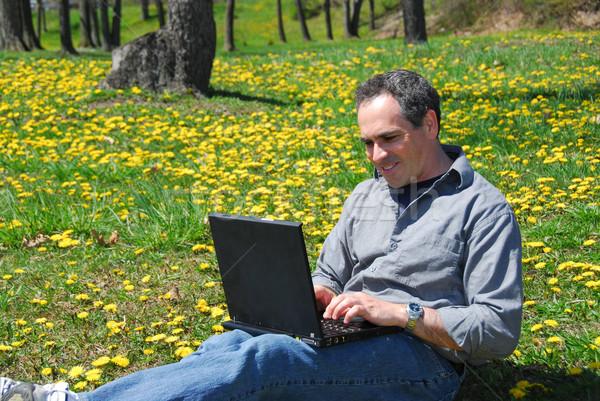 Man work outside computer Stock photo © elenaphoto
