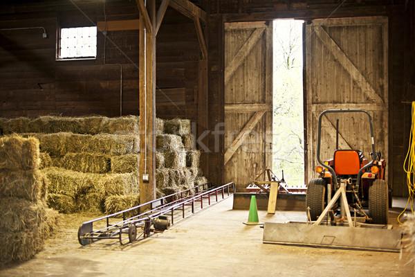 Barn interior with hay bales and farm equipment Stock photo © elenaphoto