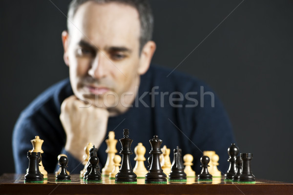 Man playing chess Stock photo © elenaphoto
