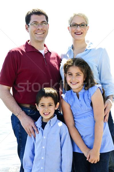 Stok fotoğraf: Mutlu · aile · portre · dört · ayakta · aile · gülümseme
