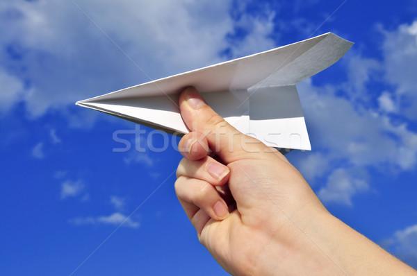 Hand holding paper airplane Stock photo © elenaphoto