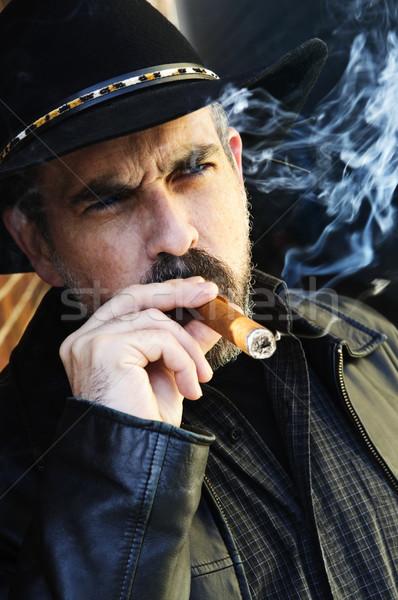 Bearded man smoking cigar Stock photo © elenaphoto
