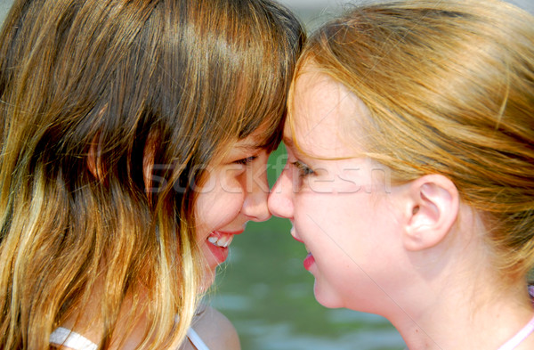 Two girls faces Stock photo © elenaphoto