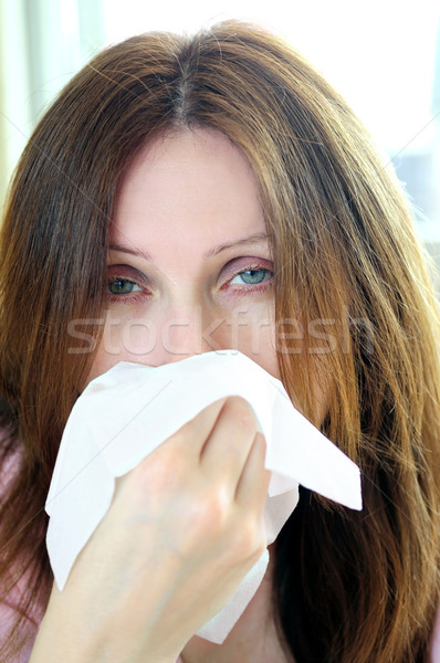 Woman with flu or allergy Stock photo © elenaphoto
