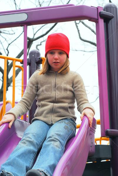 Fille slide aire de jeux jeune fille vers le bas mains Photo stock © elenaphoto