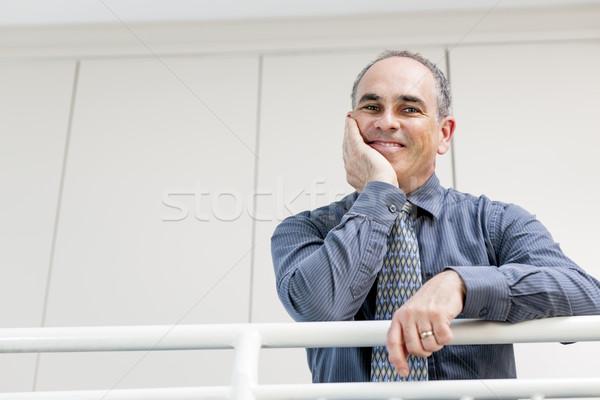 Feliz empresario pie pasillo retrato sonriendo Foto stock © elenaphoto