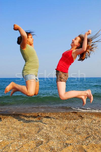 Girls jumping Stock photo © elenaphoto