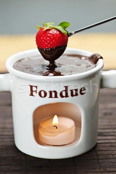 Strawberry dipped in chocolate fondue Stock photo © elenaphoto