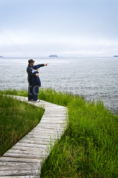 Father and son at Atlantic coast in Newfoundland Stock photo © elenaphoto
