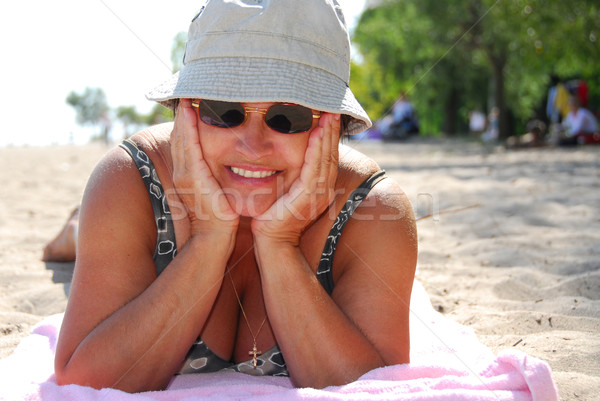 Mature woman beach Stock photo © elenaphoto