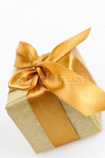 Golden wrapped gift box Stock photo © elenaphoto