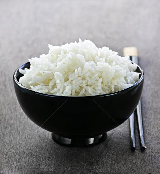Rice bowl with chopsticks Stock photo © elenaphoto