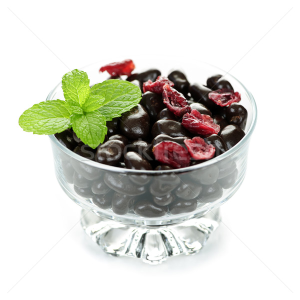 Bowl of chocolate coated cranberries Stock photo © elenaphoto