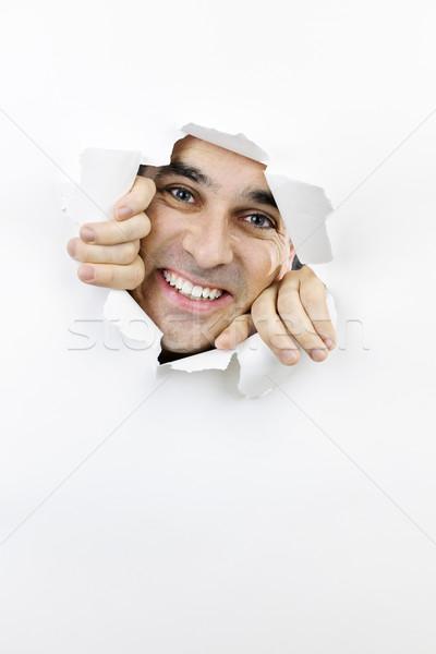 Blij gezicht naar gat papier gescheurd papier glimlachend Stockfoto © elenaphoto