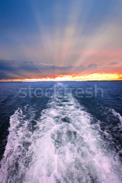 Sunset over ocean with boat wake Stock photo © elenaphoto