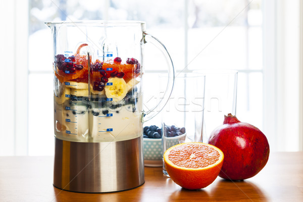 Preparing smoothies with fruit and yogurt Stock photo © elenaphoto