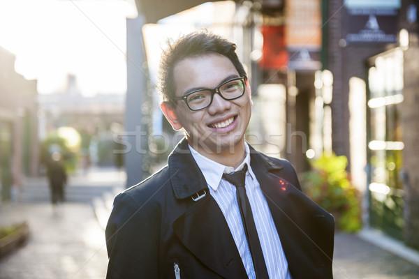 Jovem asiático homem rua óculos Foto stock © elenaphoto