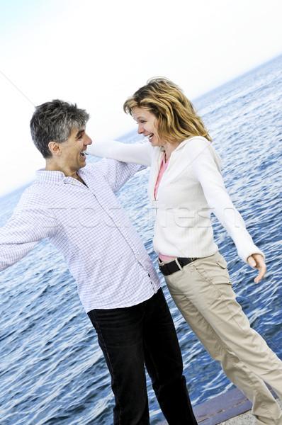 Carefree mature couple Stock photo © elenaphoto