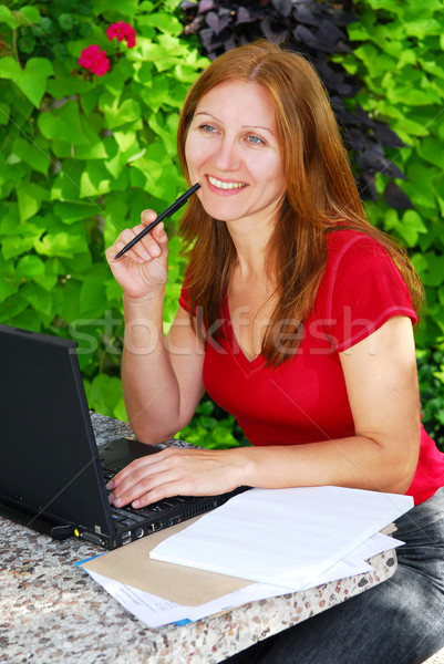 Woman working at home Stock photo © elenaphoto