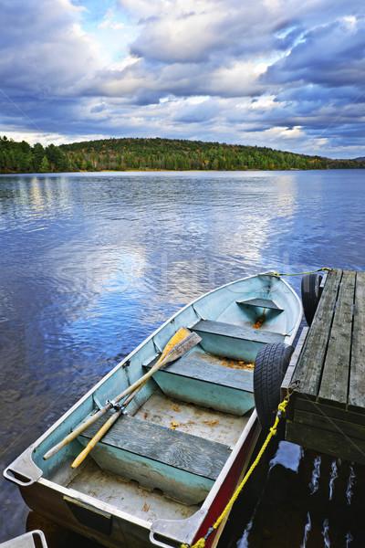 Rowboat docked on lake Stock photo © elenaphoto
