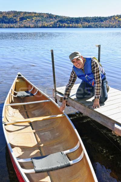 Homem canoa doca lago dois Foto stock © elenaphoto