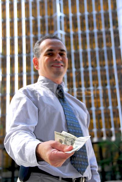 Businessman offer money Stock photo © elenaphoto