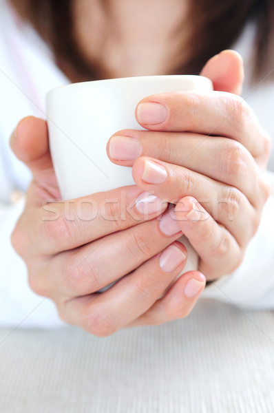 Hands holding a cup Stock photo © elenaphoto