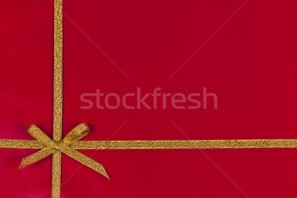 Red gift background with gold ribbon Stock photo © elenaphoto