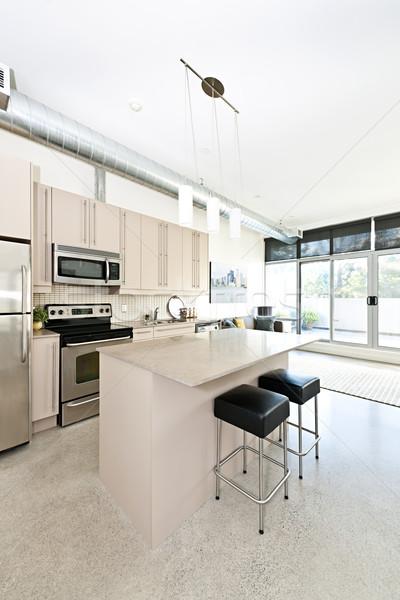 Modern condo kitchen and living room Stock photo © elenaphoto
