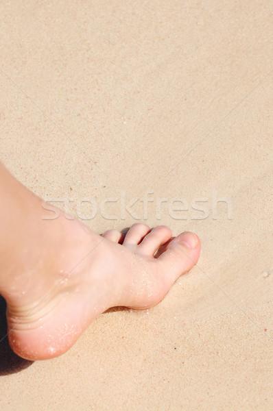 Foot on sandy beach Stock photo © elenaphoto