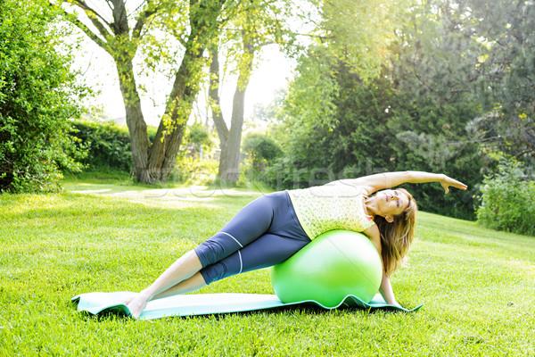 Nő jóga egyensúlyozó labda női fitnessz oktató Stock fotó © elenaphoto