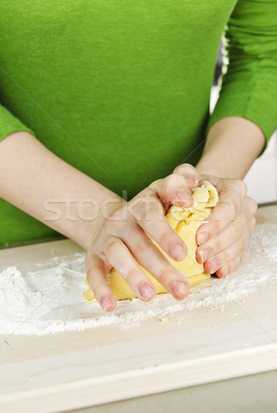Hands kneading dough Stock photo © elenaphoto
