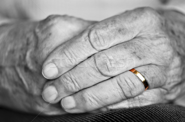 Old hands with wedding band Stock photo © elenaphoto