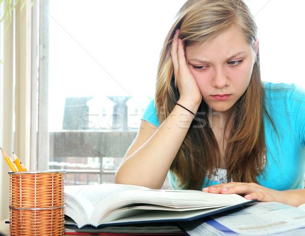 Teenage girl studying with textbooks Stock photo © elenaphoto