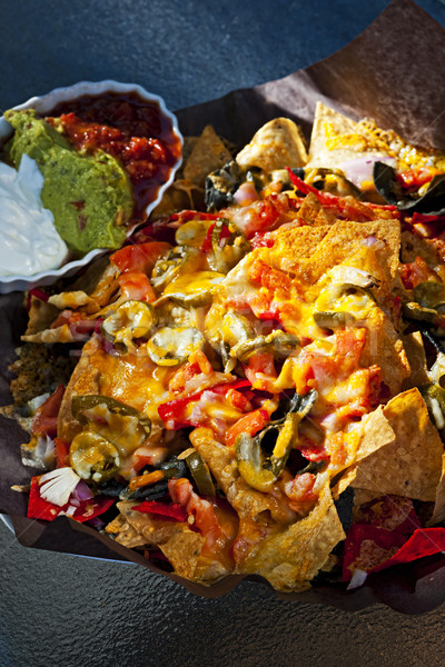 Nacho basket with cheese Stock photo © elenaphoto