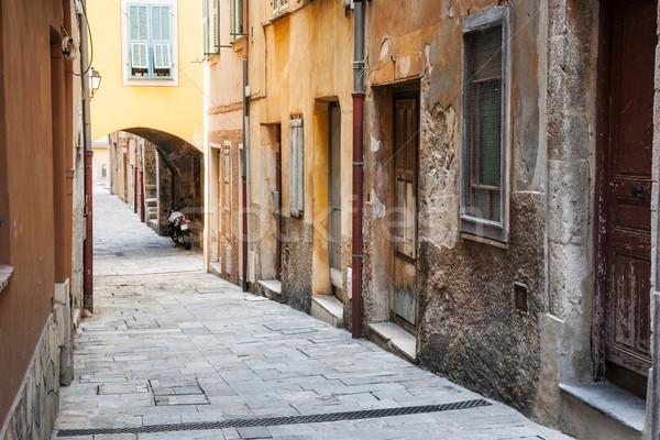 öreg házak keskeny utca macskakő középkori Stock fotó © elenaphoto
