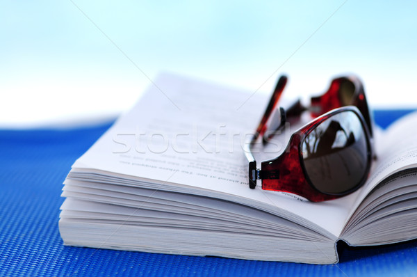 Stock photo: Sunglasses and book on beach chair
