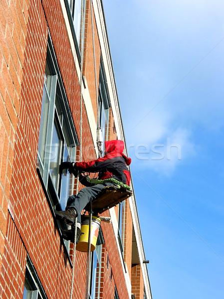 Pencere yıkayıcı çalışma Bina duvar adam Stok fotoğraf © elenaphoto