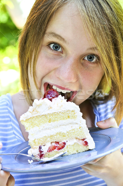 Girl eating a cake Stock photo © elenaphoto