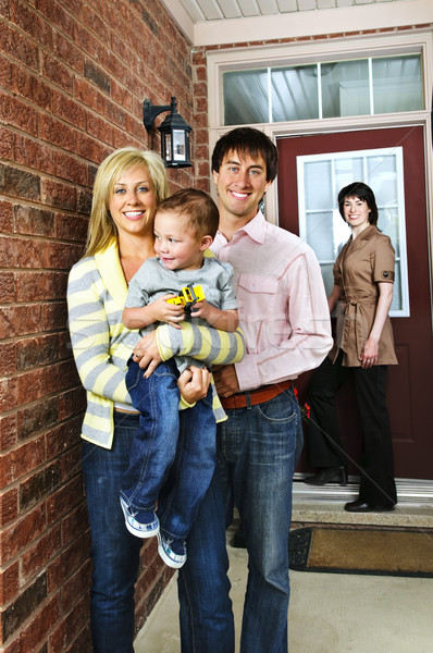 Happy family with real estate agent Stock photo © elenaphoto