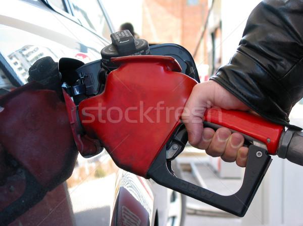Benzinpumpa kéz tart pumpa fúvóka autó Stock fotó © elenaphoto